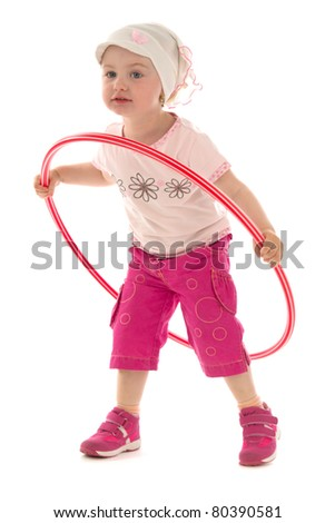 Girl exercises with hula hoop,on white background.