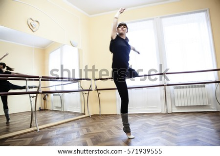 Girl exercising on the rhythmic gymnastics #571939555