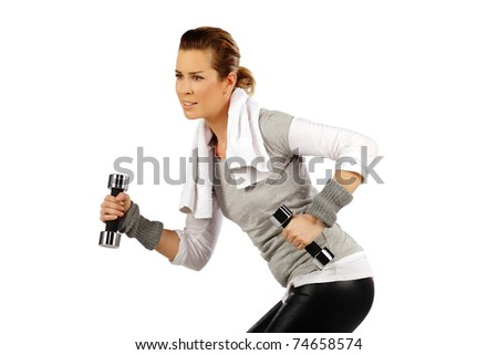 Girl exercising with weights, on a white background