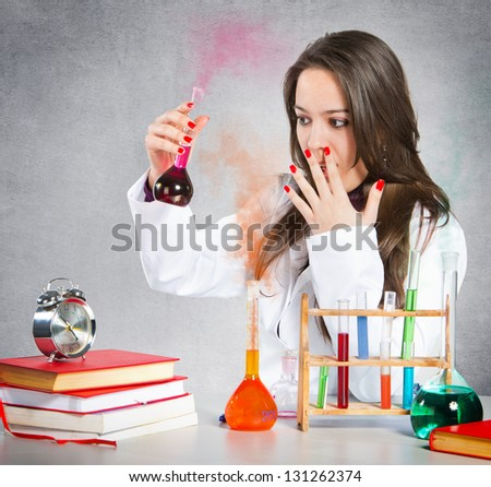 Girl experimenting with chemical liquids