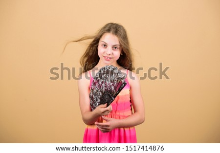 Girl fanning herself with fan. Air circulation. Art and culture. Handheld fan create airflow. Airflow from handfans increases evaporation. Cooling effect. Folding fans. Acting school. Dances with fan. #1517414876