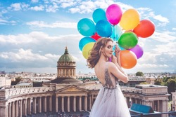 Girl, fashion model with balloons on the background of St. Petersburg, Russia. Kazan Cathedral