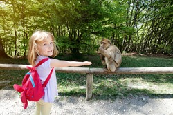 Girl feeding monkey