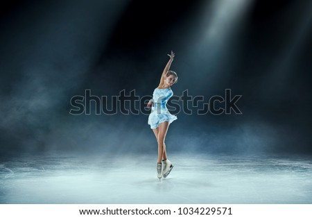 girl figure skating at ice arena #1034229571