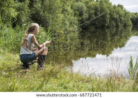 girl fishing at lake in summer vacation