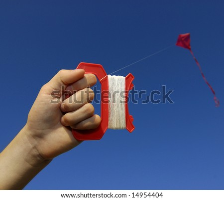 Girl flying a kite in a park with blue sky