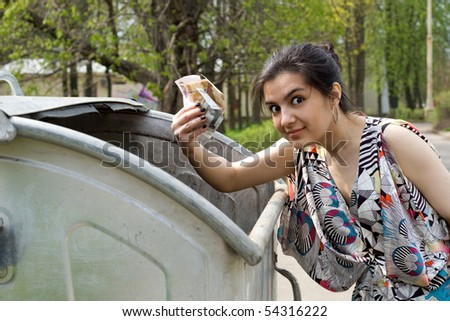 Girl found money in a garbage can