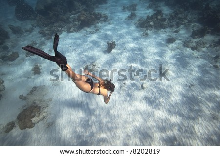 Girl free diving in the ocean, Andaman Sea, Thailand.