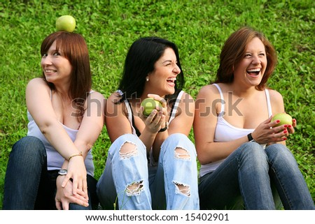 girl friends with apples outdoor