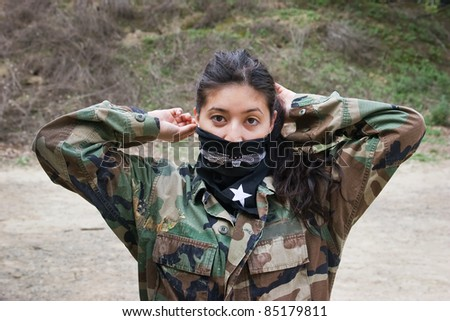 Girl gets ready for a round of paintball.