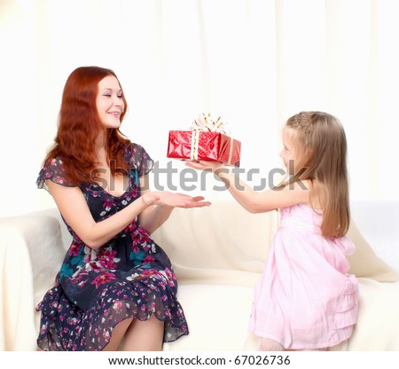 Girl gives present to mother
