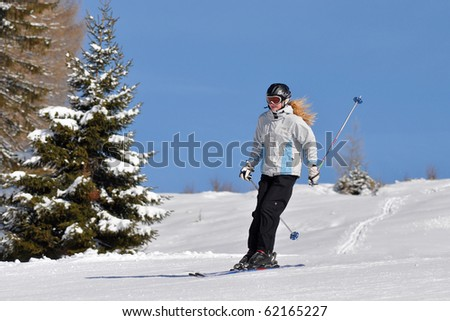 girl going down-hill with fluttering hair