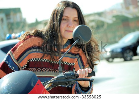 girl going on a motorcycle without a helmet
