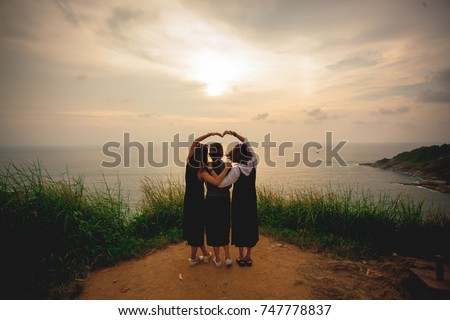 Girl group three best friends. Travel sea watching sunset on the hill. Love signs heart