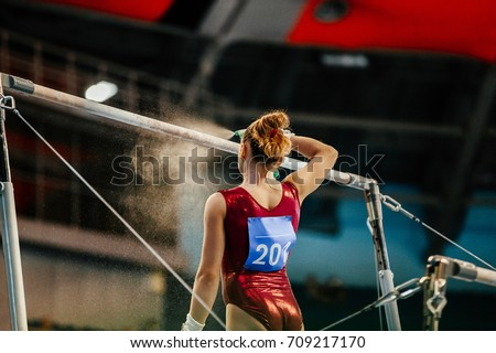 girl gymnast athlete get ready in uneven bars