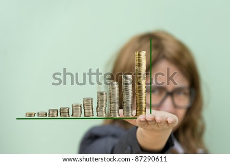 girl hand holding coin graph