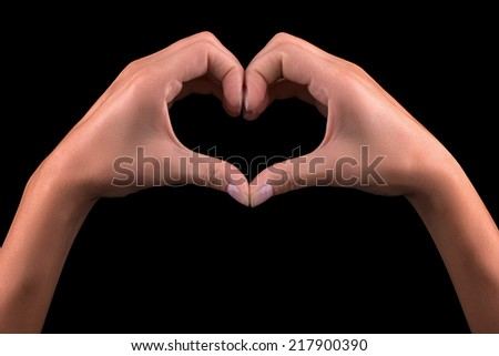 Girl hand in heart isolated on black background #217900390