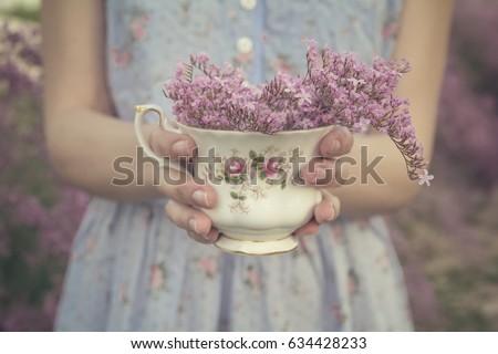 girl hands holding a fine bone...