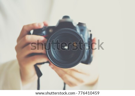 girl hands holding photo camera ...