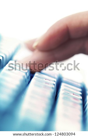 girl hands typing on keyboard macro close up