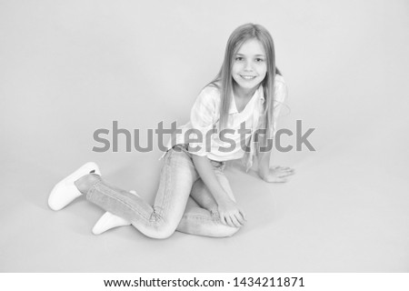 Girl happy face sit on floor attentive looking at camera turquoise background. Kid girl with long hair relaxing. Just relaxing here. Feel comfortable and freely. Time to relax. Find place to relax. #1434211871