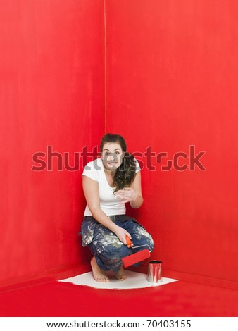 Girl has painted herself in the corner