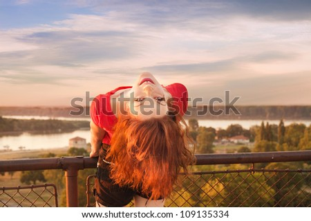 girl have fun on Belgrade Fortress sky, river and city in background summer day