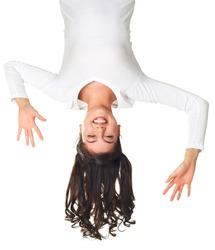 Girl having fun hanging upside down