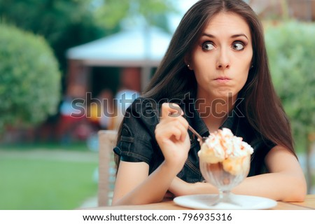 Girl Hesitating to a Eat High Calorie Ice Cream Dessert. Doubtful client trying expensive dish worried about food allergies  #796935316