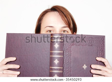 Girl hiding behind the book, staring at you