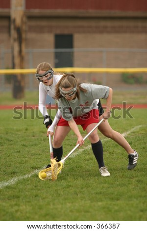 Girl high school lacrosse. Editorial use only. - stock photo