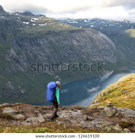 girl hiker going by path at the norwegian mountains