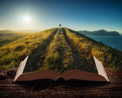 Girl hiker with backpack and trekking sticks standing on a mountain top against sunset on the pages of an open magical book. Majestic landscape. Travel concept.