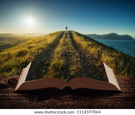 Girl hiker with backpack and trekking sticks standing on a mountain top against sunset on the pages of an open magical book. Majestic landscape. Travel concept. #1114597064
