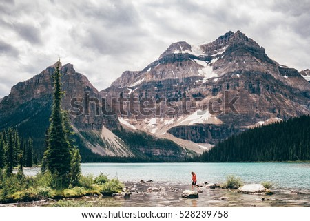 girl hiking at hidden lake ...