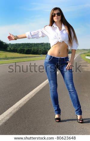 girl hitchhiking on the road