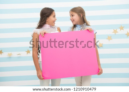 Girl hold announcement banner. Girls kids holding paper banner for announcement. Children happy with blank paper announcement copy space. Kids announcement concept. Amazing surprising news. #1210910479