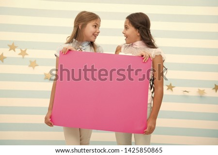 Girl hold announcement banner. Girls kids holding paper banner for announcement. Children happy with blank paper announcement copy space. Kids announcement concept. Amazing surprising news. #1425850865