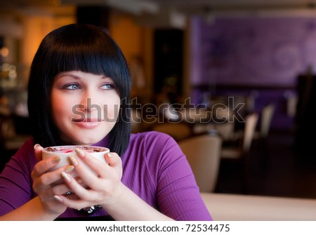 girl hold cup of coffee in hand