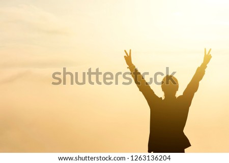 girl hold two fingers with red sky background hand sign language, winner #1263136204
