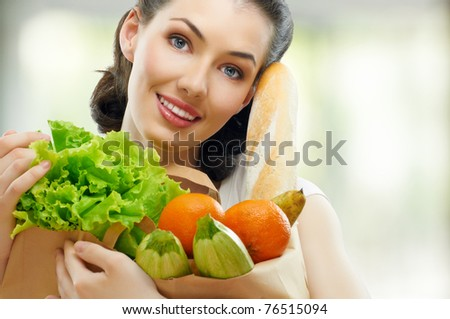 girl holding a bag of food