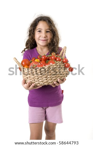 girl holding a basket of tomatoes isolated on white - stock photo