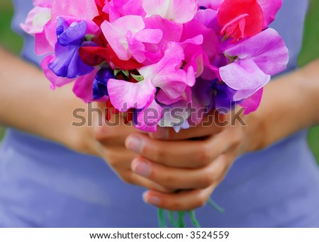 Girl holding a bouquet of sweet peas