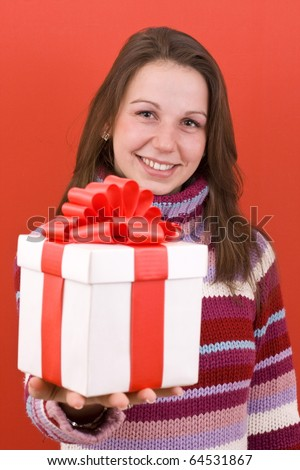 Girl holding a gift , on red background