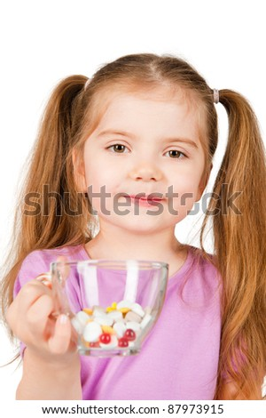 girl holding a glass of pills
