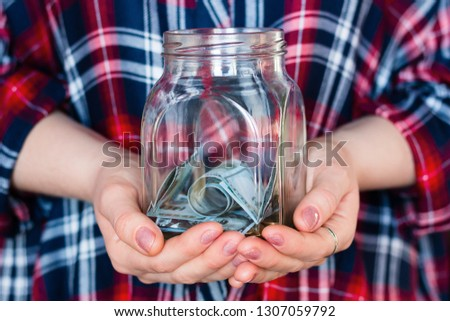 girl holding a jar for donations, fundraising, charity #1307059792