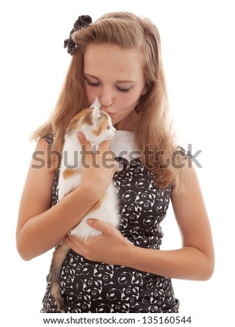 girl holding a kitten isolated on white