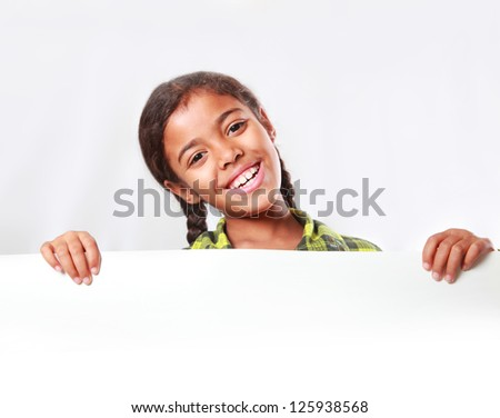 girl holding a large poster
