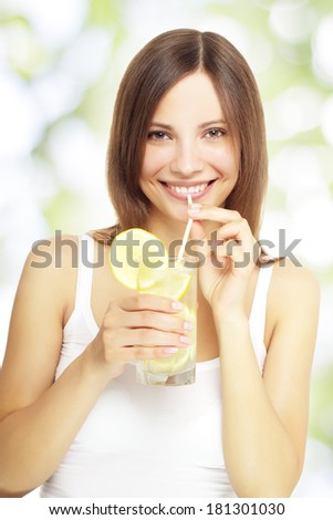 girl holding a lemonade on a light background