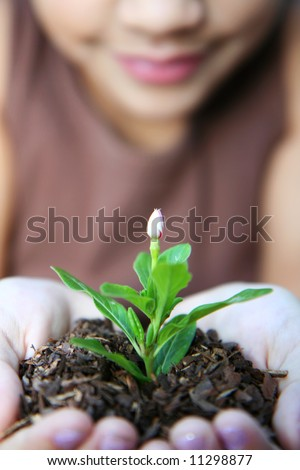 Girl holding a new flower
